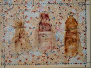 "A Trio of Dresses Encaustic with paper on birch panel 12"" by 9"", 2014, Marion Meyers, $250"