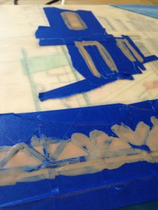 Venice: building up the smaller background areas may be a good idea at this stage so I've done the window frames and fence = very fussy! For those little wee fence strips I use an razor blade to cut strips in my tape, and I use a couple of layers of tape to make it stronger. I'll do all the verticals first, then horizontals and then the ones on the diagonal - yikes - it helps for when you peel it all up.