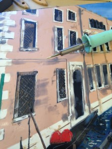 "Venice: Now I add fine detail with brass tools. I can attach a variety of nibs onto this heat tool. This one acts like a pen, wicking up paint from solid bars of paint. I can draw on those shadows, window grills, balconies, fence posts, waves in the water. This tool fuses the paint on so that I don't have to fuse - but I can if I want! I also have little brass ""paint brush"" and it's good for those larger shaded areas or individual brinks."
